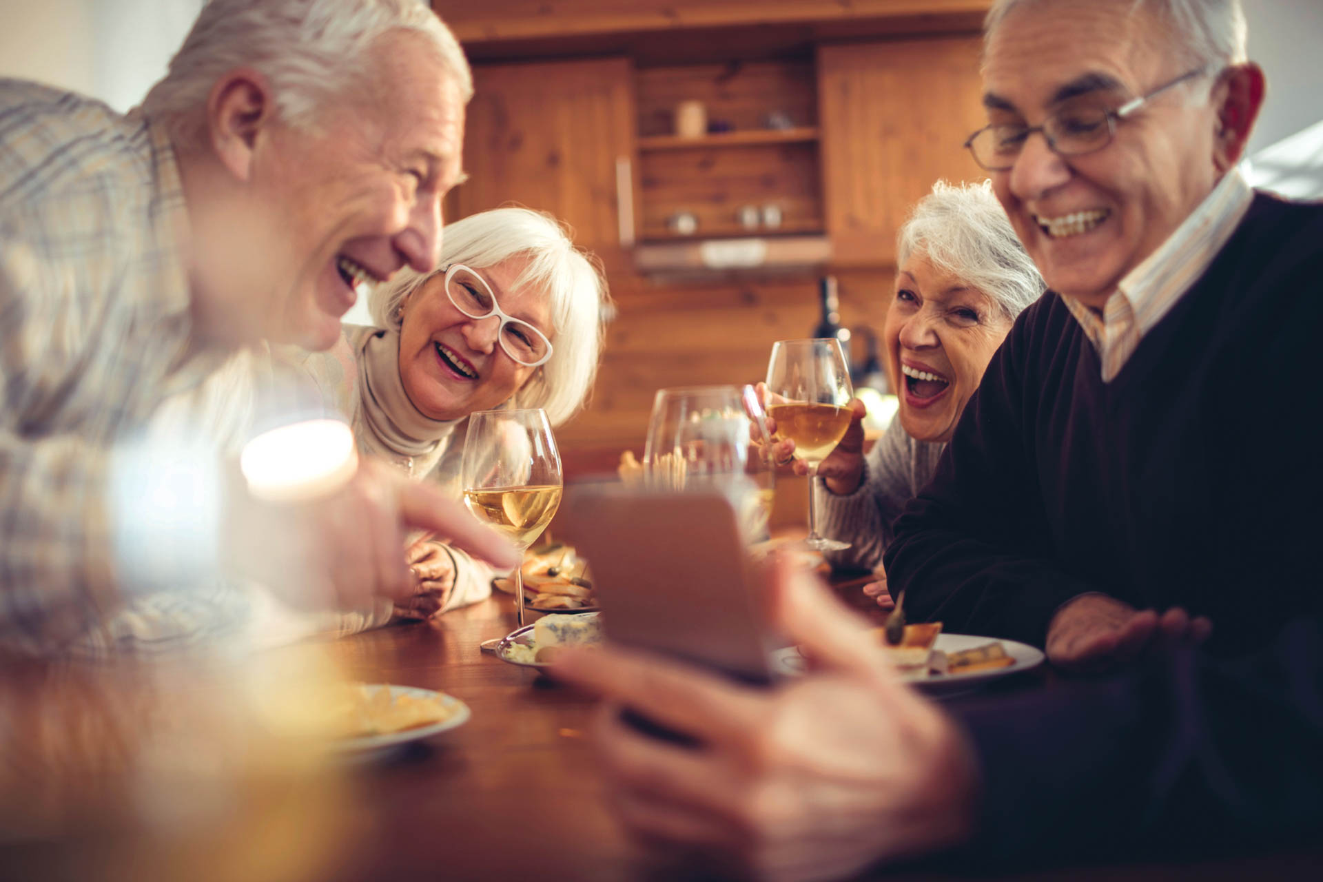 Photo of senior adults laughing together.