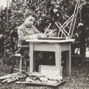 Vintage photo of a child working at a desk.