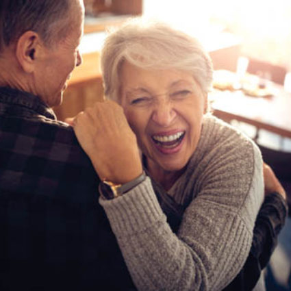 Close up of a senior couple dancing.