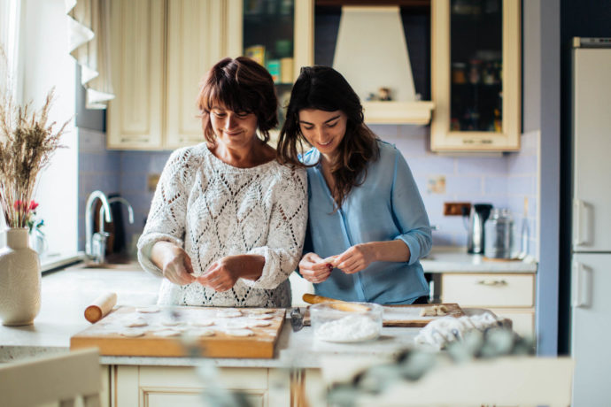Mother and daughter baking in the kitchen.